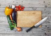foto of chef knife  - Knife and wood cutting board with fresh vegetables for recipe ingredients - JPG