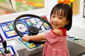 stock photo of bus driver  - Little Asain Chinese Bus Driver at indoor playground - JPG