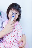 picture of inhalant  - Doctor helps little asian  - JPG