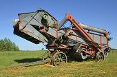 stock photo of threshing  - Old threshing machineAn old threshing machine is in great working order and provides a look at yeast - JPG