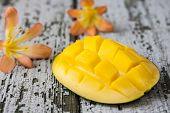 stock photo of mango  - exotic mango and mango milkshake on wooden background - JPG
