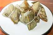 foto of chinese wok  - Zongzi in a plate - JPG