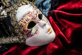 stock photo of venetian carnival  - Close up carnival venetian mask  on purple velvet background - JPG