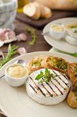 pic of baguette  - Grilled camembert with Dijon mustard and herbs baguettes