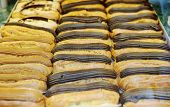image of eclairs  - Tasty eclairs on in french bakery store in three rows with cacao brown and black chocolate - JPG