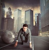 foto of disadvantage  - Man stuck in a challenge by an obstacle - JPG