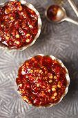 stock photo of chillies  - Extreme hot asian chillies garlic sauce  - JPG