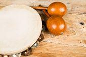 stock photo of maracas  - Tambourine and maracas on a wooden table - JPG