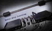 stock photo of typewriter  - Vintage inscription made by old typewriter Never stop learning - JPG
