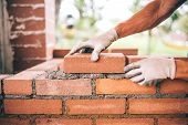 Professional Construction Worker Laying Bricks And Building Barbecue In Industrial Site. Detail Of H poster