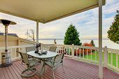 Постер, плакат: Awesome Water View From The Wooden Deck With Patio Table