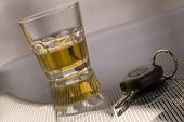 stock photo of blood drive  - car keys with glass of whiskey in background  - JPG