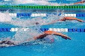 stock photo of swim meet  - swimming in waterpool with blue water - JPG