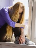 People And Solitude Concept. Alone Sad Young Woman Long Hair Teen Girl Sitting On Window Sill Lost I poster
