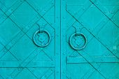 Metal Green Aged Textured Door With Rings Door Handles And Metal Details. Metal Architecture Backgro poster