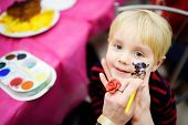 Face Painting For Cute Little Boy During Kids Merriment. Face Paint For pirates Theme On Birthday  poster