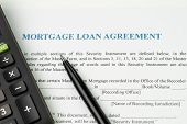 Mortgage Loan Agreement Sign Contract Concept, Pen With Calculator On Mortgage Form Or Contract, Lon poster