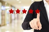 Businesswoman Hand Pointing Red Five Star Over Blur Background, Customer Excellent Rating Satisfacat poster