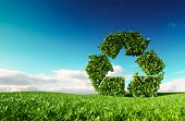 Eco Friendly Recyclation Concept. 3d Rendering Of Green Recycle Icon On Fresh Spring Meadow With Blu poster