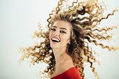 Woman With Happy Face And Curly Hair. Portrait Of Funny Positive Girl With Curly Hair Isolated On Wh poster
