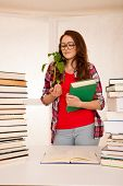 Attractive Young Botany Student With Seedlnng And Books poster