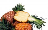 ananas on white, one of them cut in half  poster