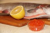Rainbow Trout Fish Red Caviar And Lemon. Cooking Fish Dish With Lemon. Tasty Fish Dish. Cooking Red  poster