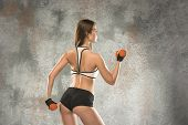 Muscular Young Female Athlete On Grey Background. Caucasian Woman With Fit Body Posing Confident. Co poster