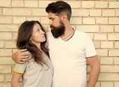 Moments Of Intimacy. Couple In Love. Family Couple Hugging On Brick Wall. Loving Couple Of Bearded M poster