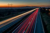 Cars Light Trails On A Straight Highway At Sunset. Night Traffic Trails, Motion Blur, Night City Roa poster