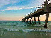 Pensacola Beach With Turquoise Waters, Waves And Pier Entering Into Gulf Of Mexico. Clouds Visible,  poster