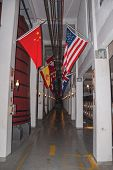 Corridor With Tanks For Wine Storage And Flags From Several Countries At The Aurora Winery Facilitie poster