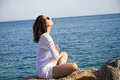 Girl Doing Yoga On Tropical Beach. Yoga On The Beach. Yoga Lifestyle. Healthy Lifestyle. Girl Doing  poster