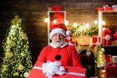 Happy New Year. Surprised Santa Claus Holds Present Box. Santa With Box. Bearded Man In Santa Claus  poster