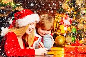 Mom And Kid Play Together Christmas Eve. Happy Family. Family Holiday. Santa Claus Coming. Mother An poster
