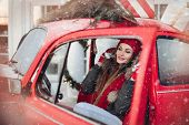 Pleasant Fashionable Winter Girl Smiling Posing At Red Vintage Car Surrounded By Snowflakes poster