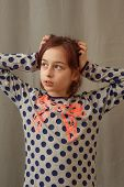 Beautiful Young Girl In Pajamas. Girl In Pajamas. Girl 9 Years Old In A Gray Dress With Blue Polka D poster
