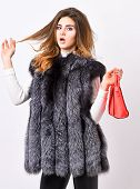 Fashion And Shopping Concept. Woman In Fur Coat With Handbag On White Background. Girl Fashion Lady  poster