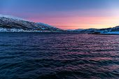 Sunset With Amazing Magenta Color Over Fjord Tromso, Norway. Winter. Polar Night. Long Shutter Speed poster