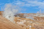 Steam Coming From Geothermal Power Plants In Iceland. A Popular Source Of Green Power Among Nordic C poster