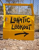 stock photo of lunate  - Classic Australian outback bush humour with a car door pointing to Lunatic Lookout - JPG
