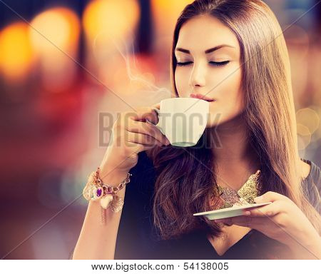 Coffee. Beautiful Girl Drinking Tea or Coffee in Cafe. Beauty Model Woman with the Cup of Hot Bevera poster