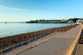 Paignton beach Torbay Devon England near tourist destinations of Torquay and Brixham poster
