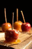 Close up of toffee apples on rustic board