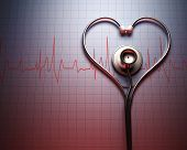 foto of heartbeat  - Stethoscope in shape of heart on a graph of the patient - JPG
