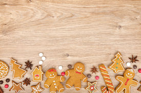 stock photo of gingerbread house  - Homemade various christmas gingerbread cookies on wooden background - JPG