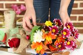 foto of compose  - Female hands composing beautiful bouquet - JPG