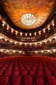 stock photo of cinema auditorium  - an old theater auditorium interior poor light - JPG