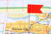 picture of kansas  - Kansas City Missouri. Red flag pin on an old map showing travel destination.