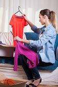 picture of independent woman  - Vertical view of woman packing her clothes - JPG
